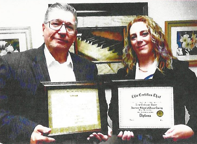 Piano Teacher and Student Receive Tuning Diplomas